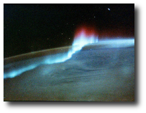 """Yeah. That's what they say. That it's beautiful."" Artwork : This photograph of the Aurora australis (Southern lights) is from Spacelab 3. Photo courtesy of R. Overmyer, ."