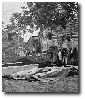 So when some Yankee officer come to the cook tent and say, hey you nigga boys got burial detail, me and the others from the colored regiment pick up our shovels and head out to the battlefield. Artwork : This photo shows four African-American men digging graves outside a hospital in Fredricksburg, Virginia, during the Civil War. It comes to us courtesy of the Library of Congress and , and is in the public domain.