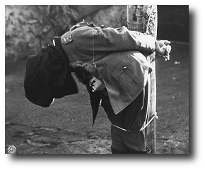 I let my round fly. Mendez fell to his knees, leaned his head back and called out to God. Artwork : Photograph of German General Anton Dostler after his execution by firing squad on 1 December 1945. This photo is in the public domain and comes to us via .