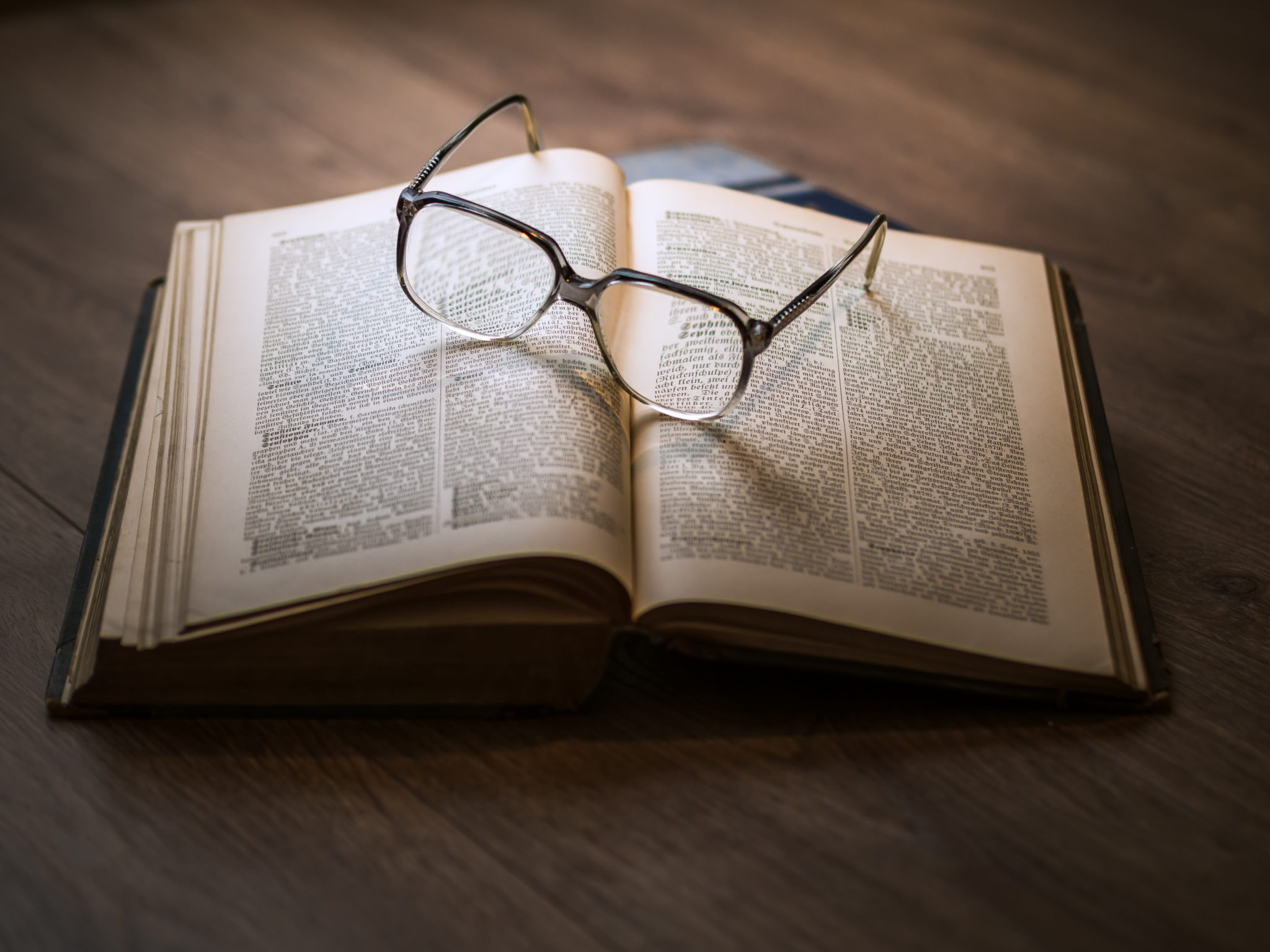Glasses on an opened book
